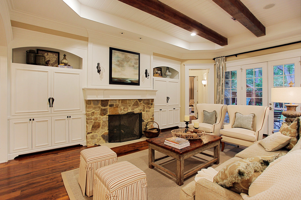 Elegant living room photo in Houston with a stone fireplace