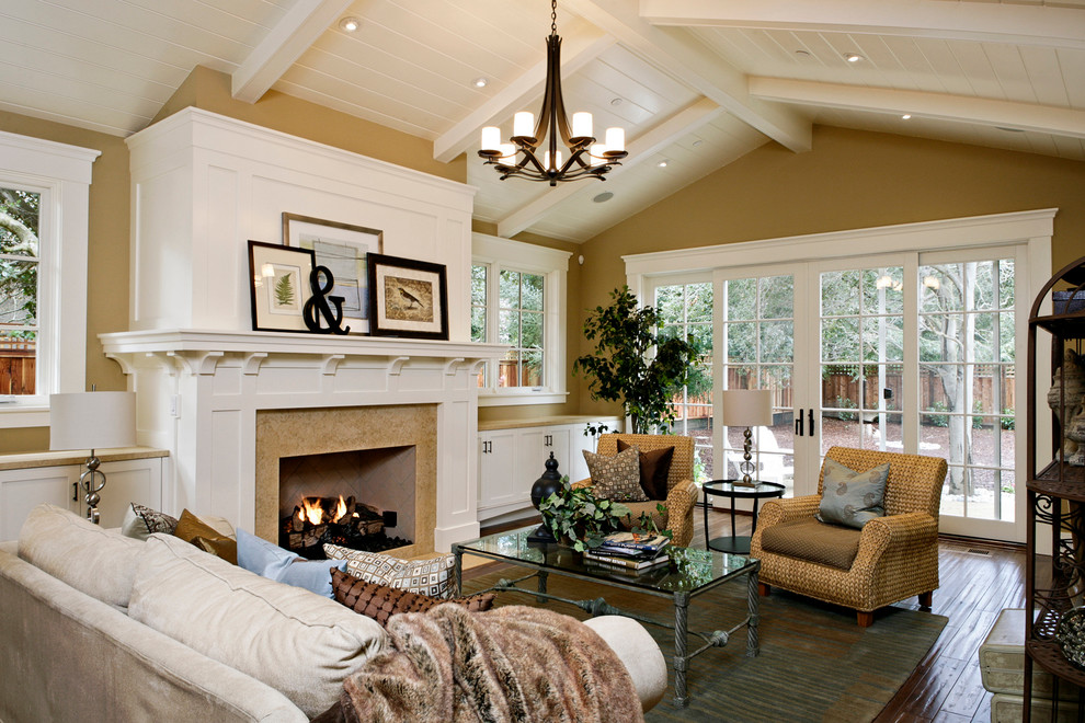 Living room - traditional living room idea in San Francisco with yellow walls, a standard fireplace and no tv