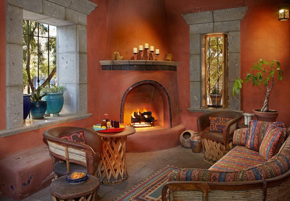 Example of a southwest brown floor living room design in Other with orange walls, a corner fireplace and a tile fireplace