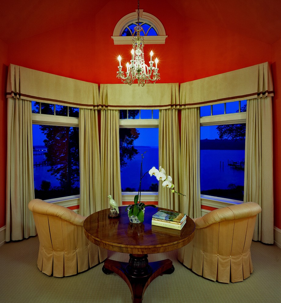 Example of a classic living room design in Miami with red walls