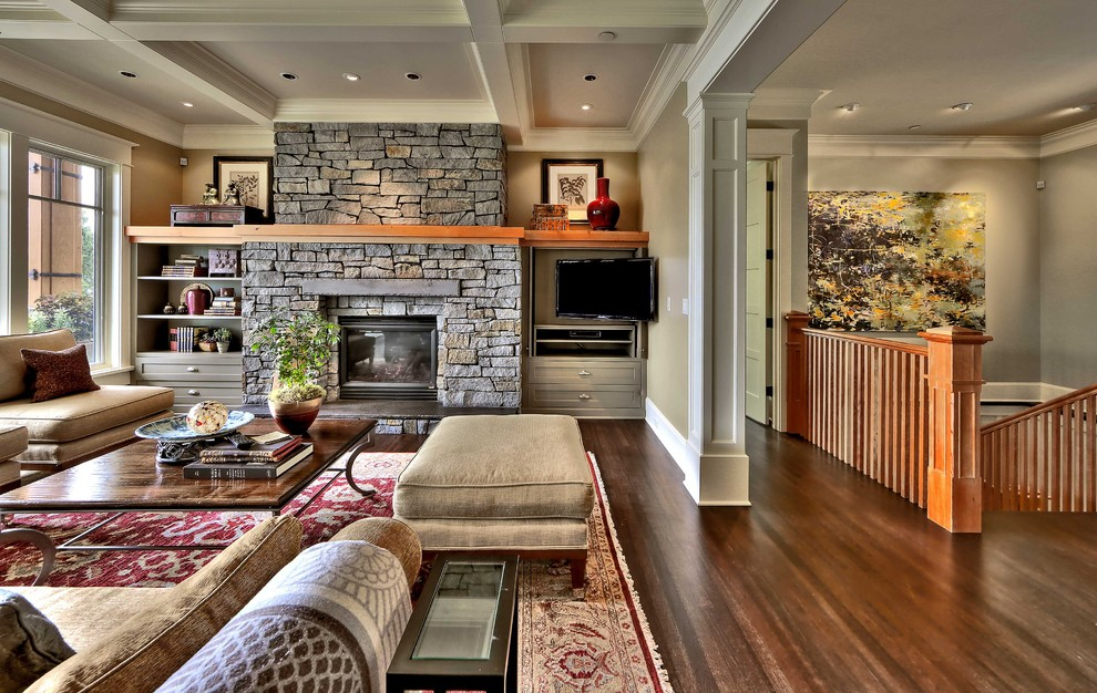 Living room - mid-sized traditional open concept dark wood floor living room idea in Seattle with beige walls, a standard fireplace, a stone fireplace and a wall-mounted tv