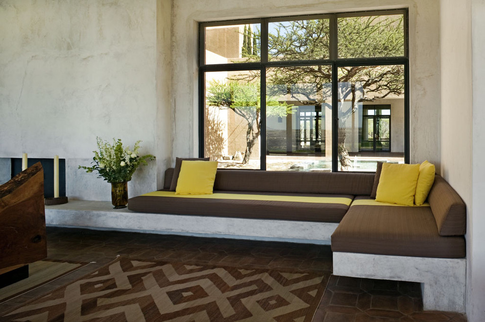 Example of a tuscan brick floor living room design in New York