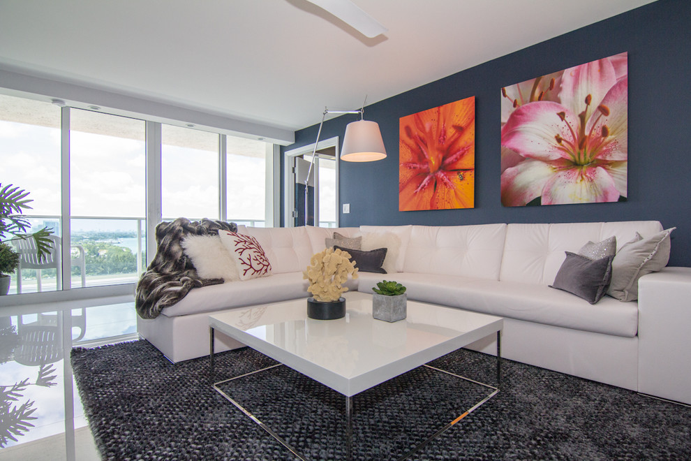 Inspiration for a contemporary living room remodel in Newark with blue walls