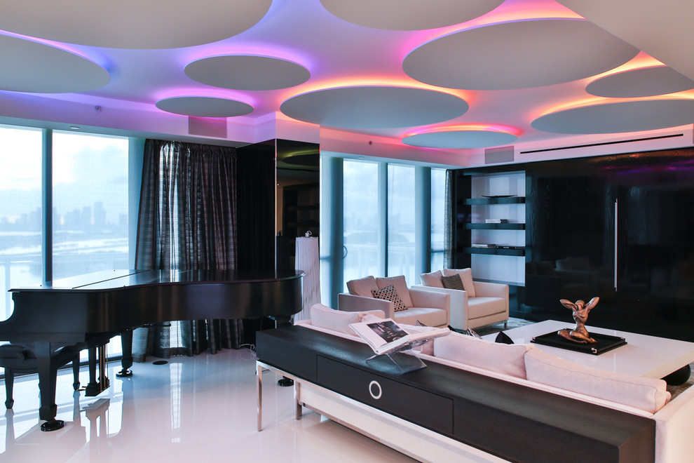 Example of a large trendy formal and open concept marble floor living room design in Miami with white walls and a media wall