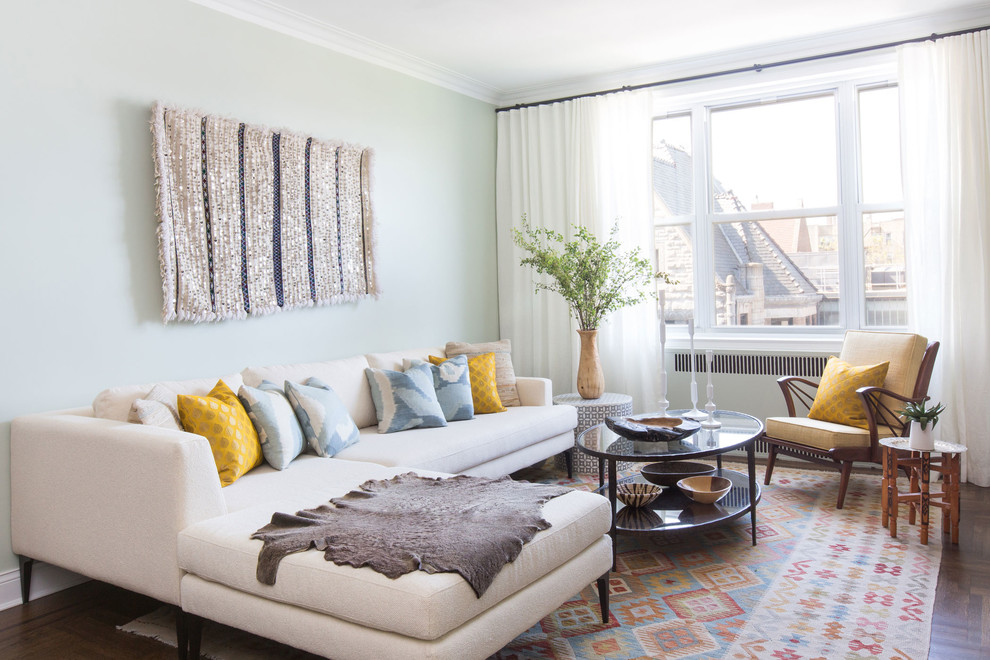 Inspiration for a transitional dark wood floor and brown floor living room remodel in New York with beige walls