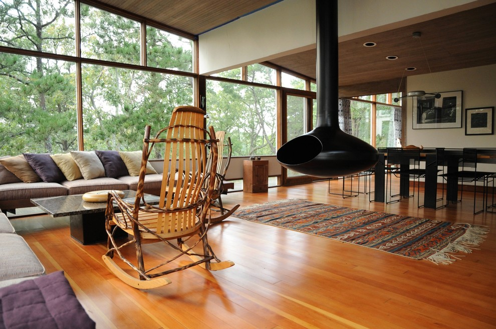 Inspiration for a 1950s open concept living room remodel in Boston with a hanging fireplace