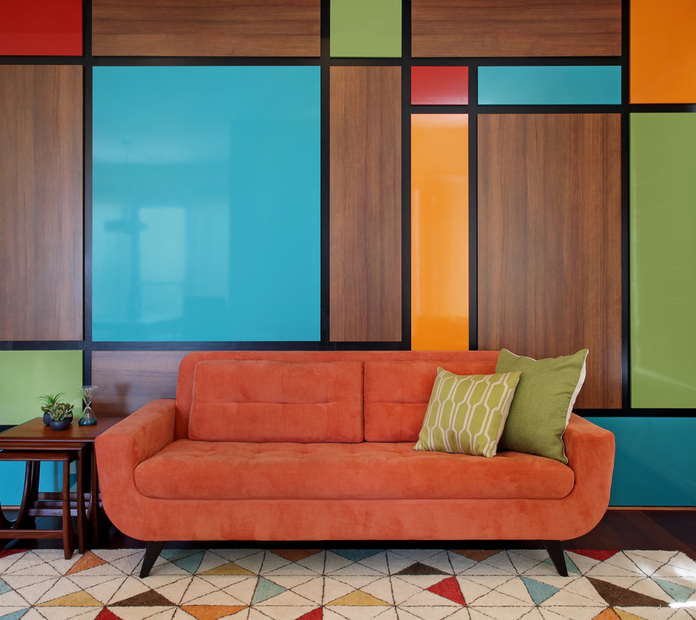 Living room - mid-sized 1960s medium tone wood floor living room idea in Orange County with multicolored walls