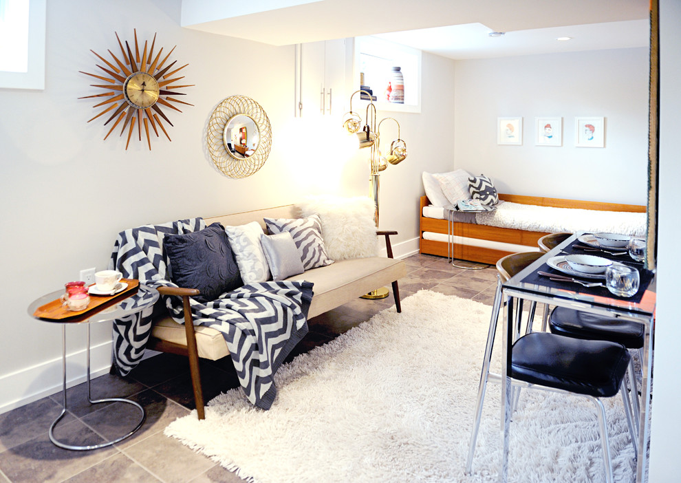 Example of a small 1950s open concept and formal ceramic floor and gray floor living room design in Calgary with white walls, no fireplace and no tv