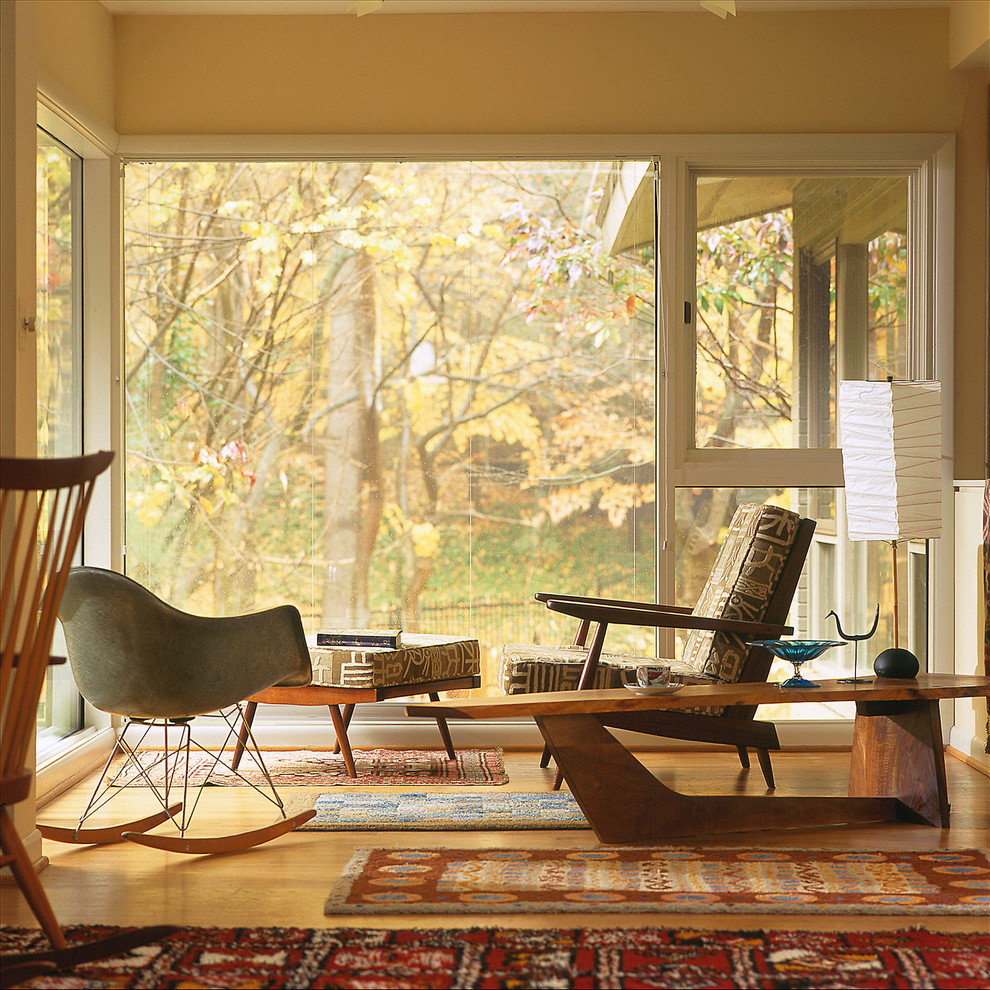 Inspiration for a 1950s medium tone wood floor living room remodel in Baltimore with beige walls