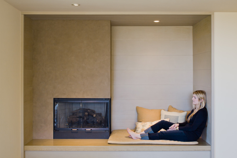 Living room - large modern open concept living room idea in San Francisco with beige walls and a standard fireplace