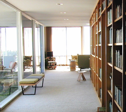 place the light walnut nelson bench against one of the glass walls and decorate it with cushions for a comfortable and relaxing reading experience