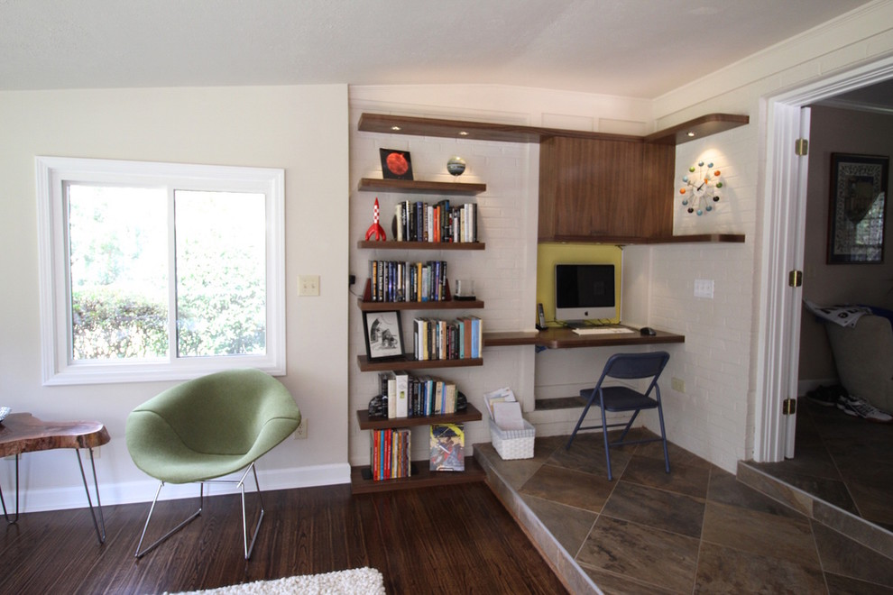 Example of a mid-sized 1950s enclosed dark wood floor living room design in Other with white walls