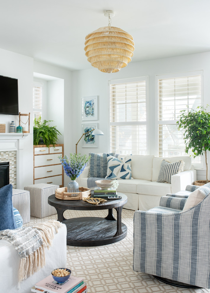 Mid-sized beach style open concept dark wood floor and brown floor living room photo in Raleigh with white walls, a tile fireplace and a wall-mounted tv