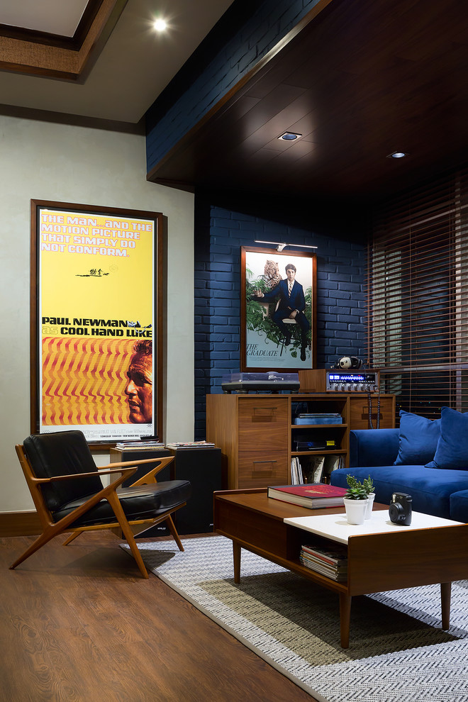 Inspiration for a mid-sized 1950s loft-style laminate floor and brown floor living room remodel in Other with a music area, blue walls, no fireplace, a brick fireplace and no tv
