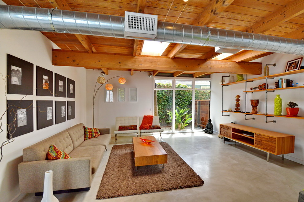 Mid-sized 1960s open concept concrete floor living room photo in Los Angeles with white walls and no tv