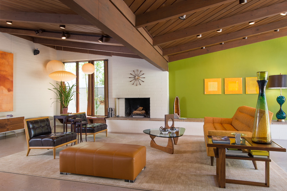 Inspiration for a large 1960s open concept living room remodel in San Diego with green walls