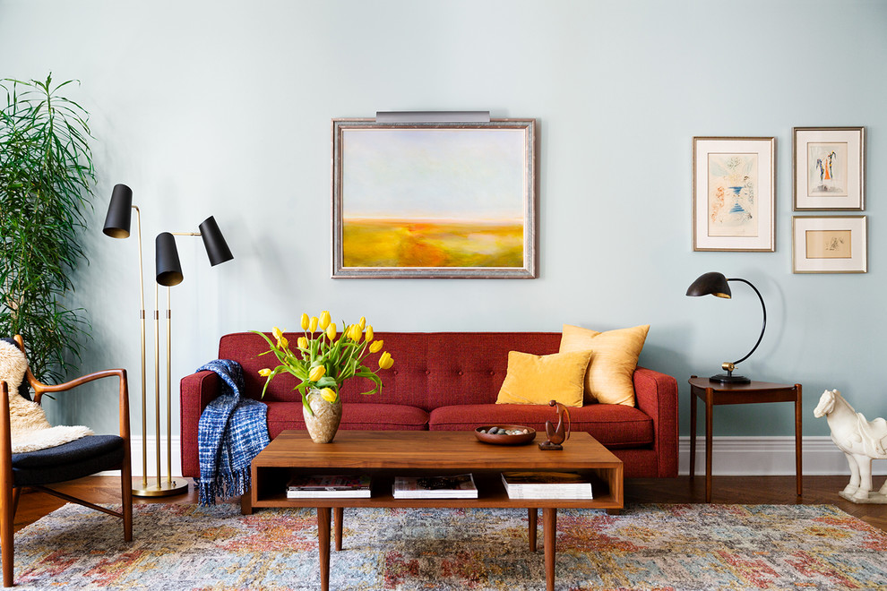 Living room - mid-sized mid-century modern medium tone wood floor and brown floor living room idea in New York with blue walls