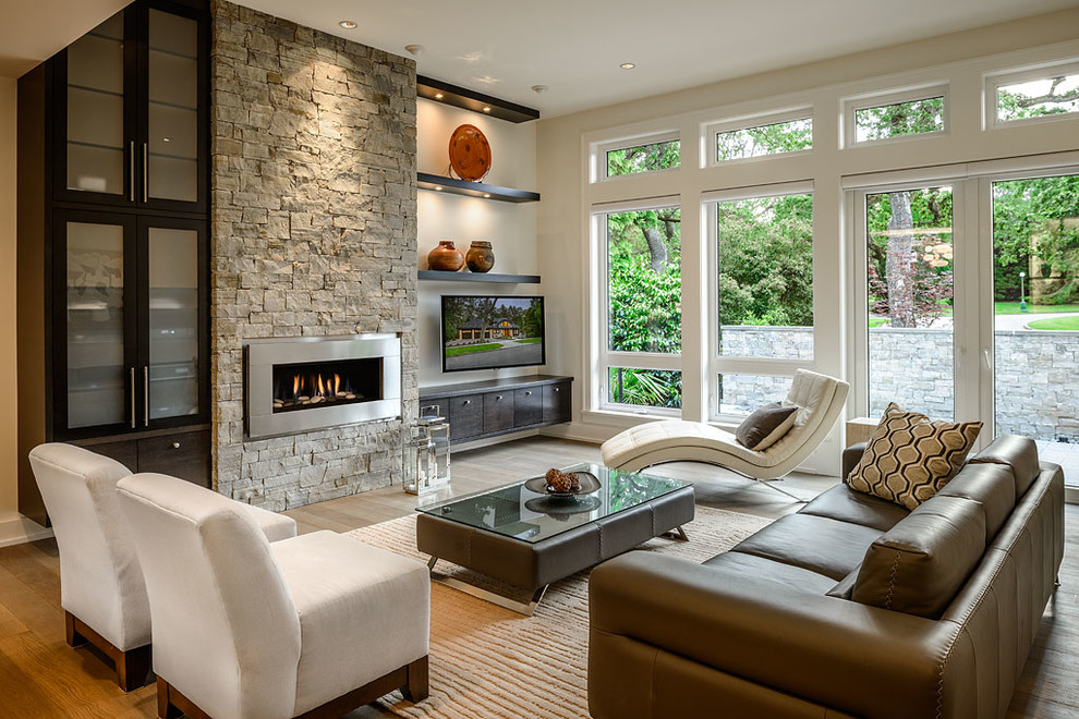 Inspiration for a contemporary living room remodel in Vancouver with a ribbon fireplace and a wall-mounted tv