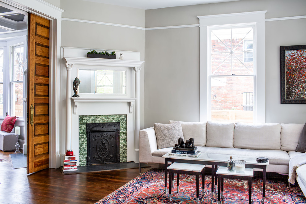 Example of a transitional enclosed dark wood floor and brown floor living room design in Atlanta with gray walls and a corner fireplace