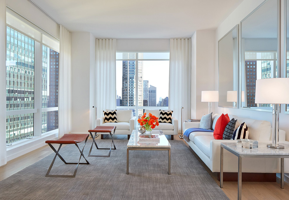 Inspiration for a mid-sized contemporary formal living room remodel in New York with white walls and no tv
