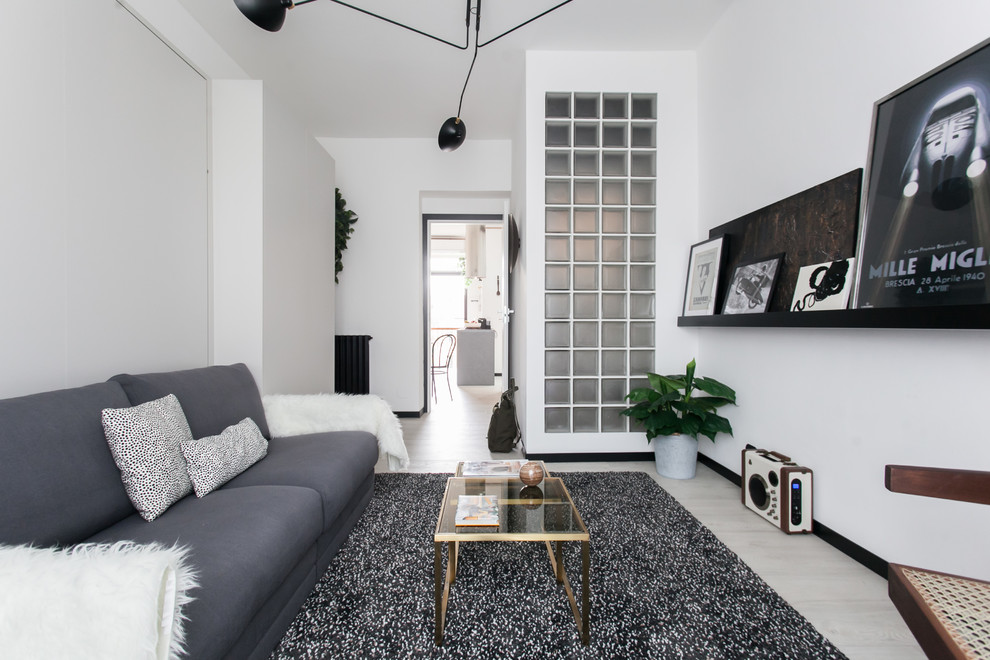 Inspiration for a scandinavian light wood floor and beige floor living room remodel in Melbourne with white walls