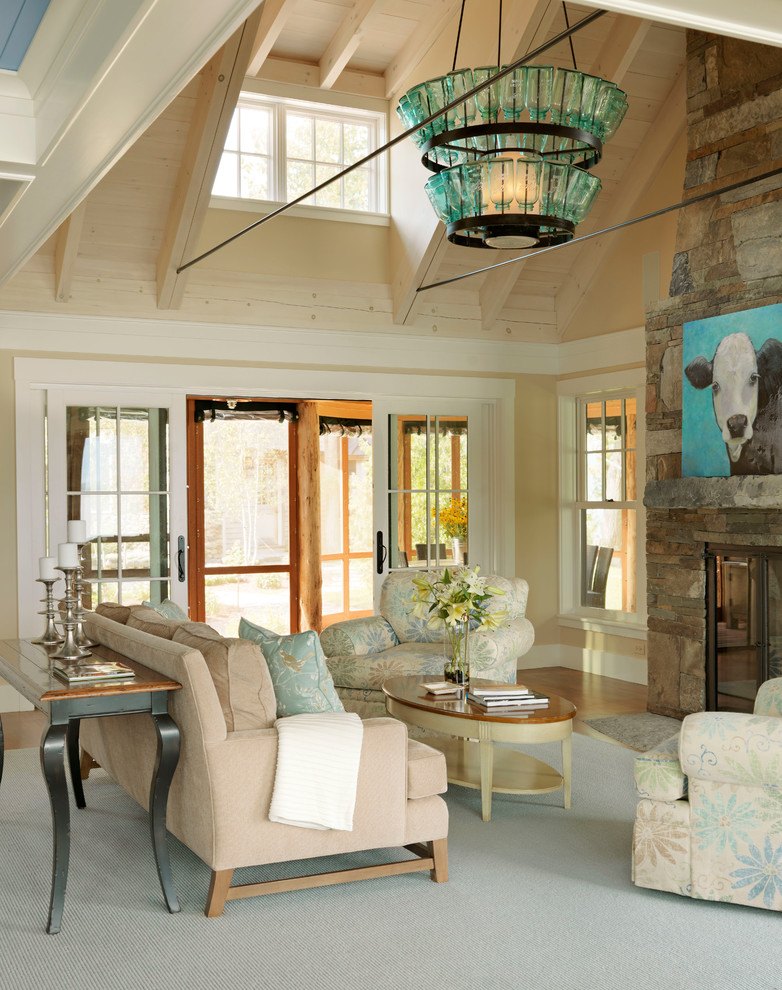 Example of a beach style formal living room design in Burlington with beige walls, a standard fireplace and a stone fireplace
