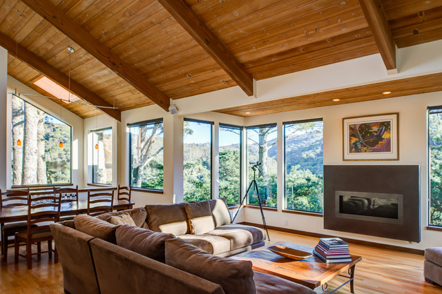 Large arts and crafts open concept light wood floor living room photo in San Francisco with a concrete fireplace
