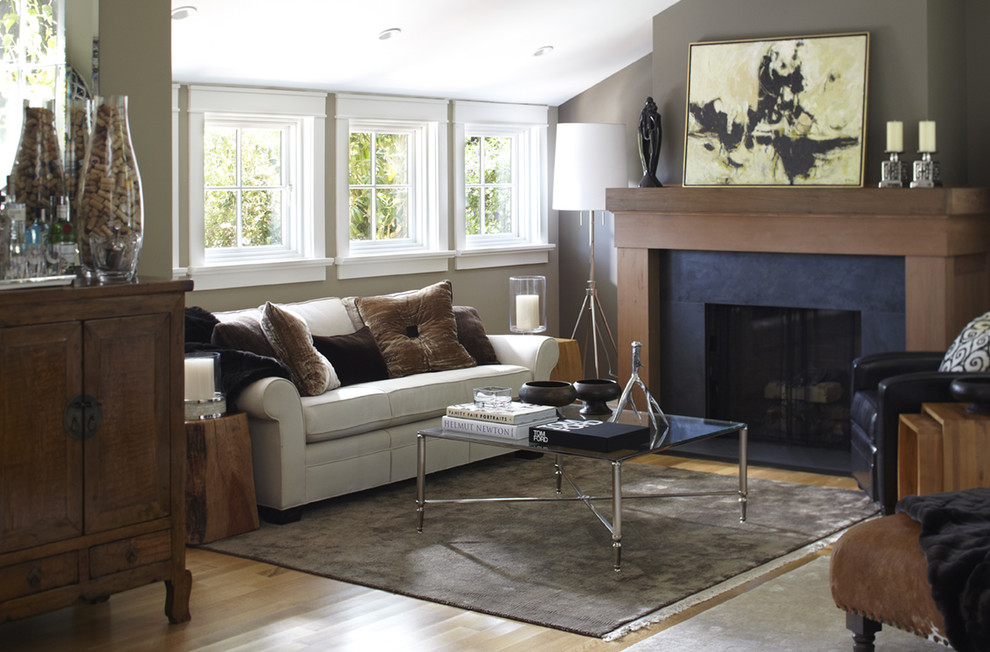 Transitional enclosed living room photo in San Francisco with gray walls and a standard fireplace