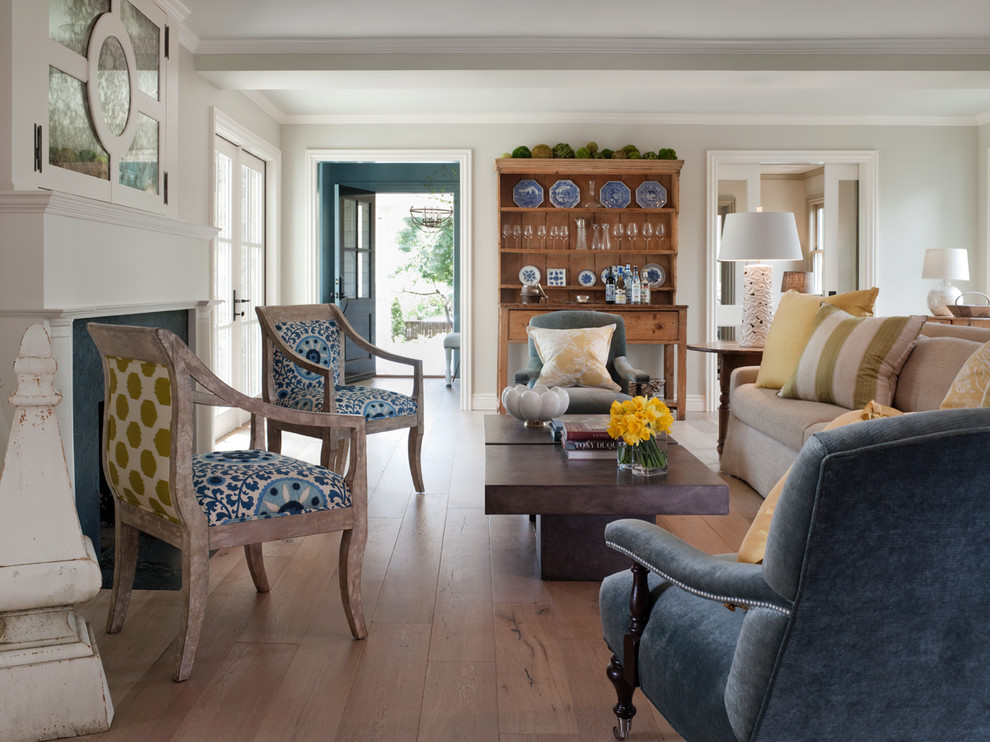 Inspiration for a timeless beige floor living room remodel in San Francisco with a concealed tv