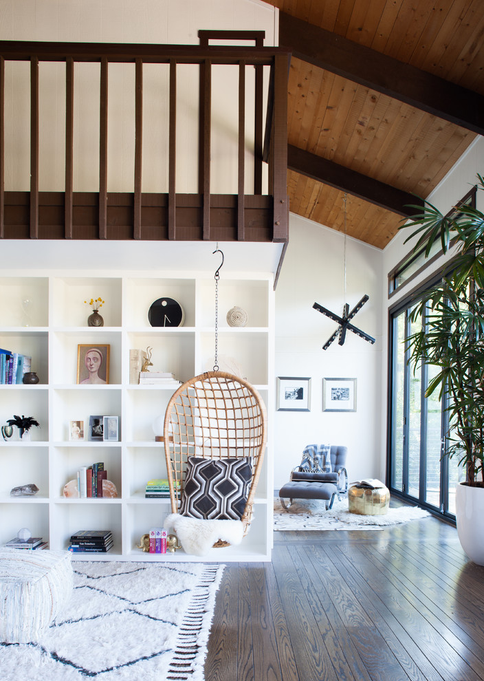 Inspiration for a large scandinavian open concept dark wood floor living room library remodel in San Francisco with white walls