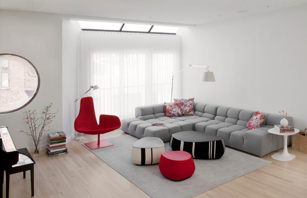 Living room - scandinavian light wood floor living room idea in Chicago with white walls