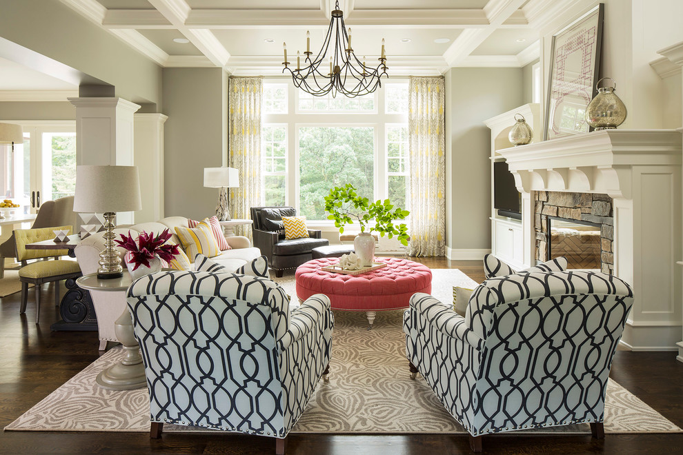 Inspiration for a transitional dark wood floor living room remodel in Minneapolis with gray walls, a stone fireplace, a standard fireplace and a media wall