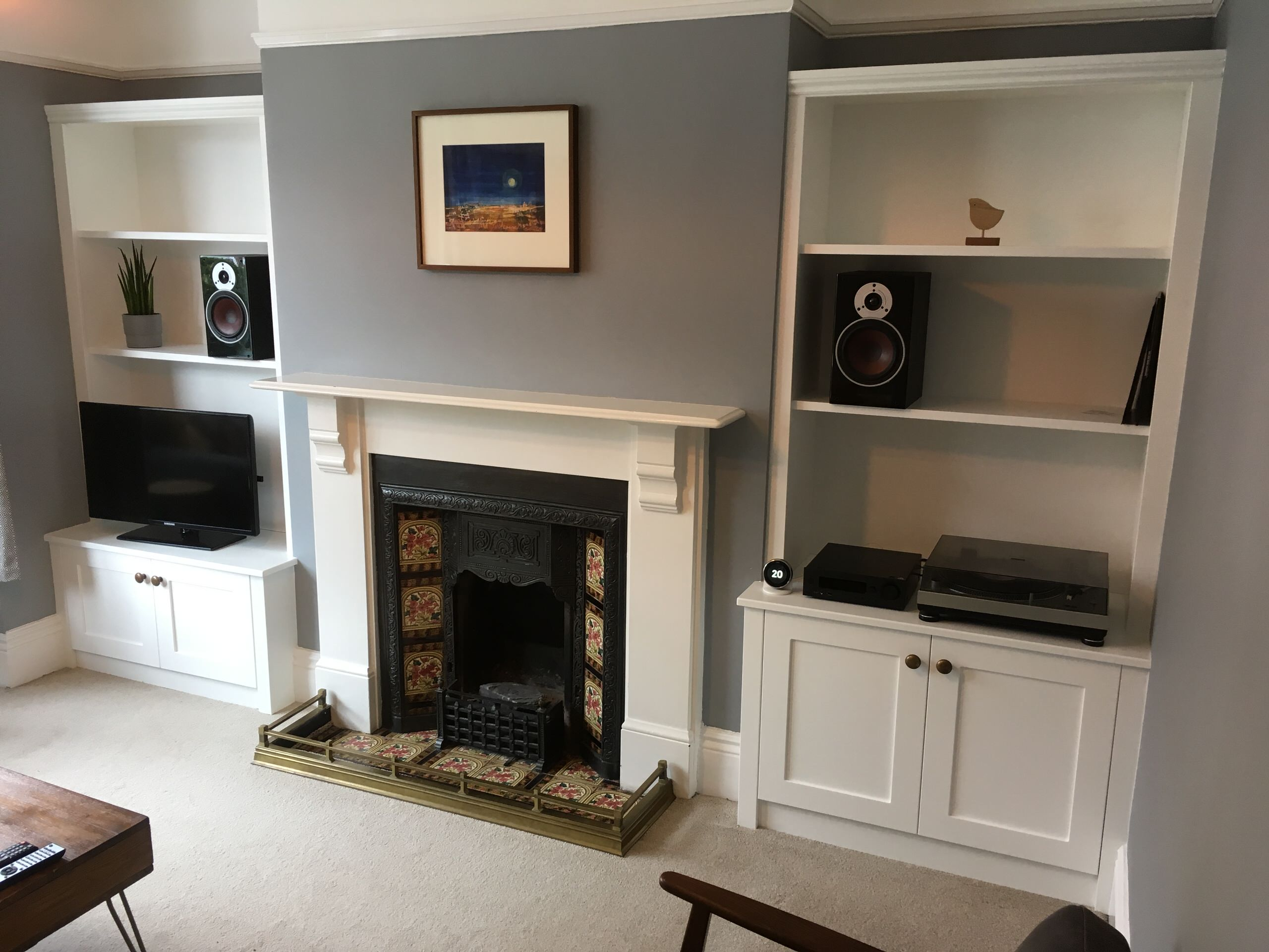 Modern Alcove Cabinets with TV and Integrated Audio Equipment