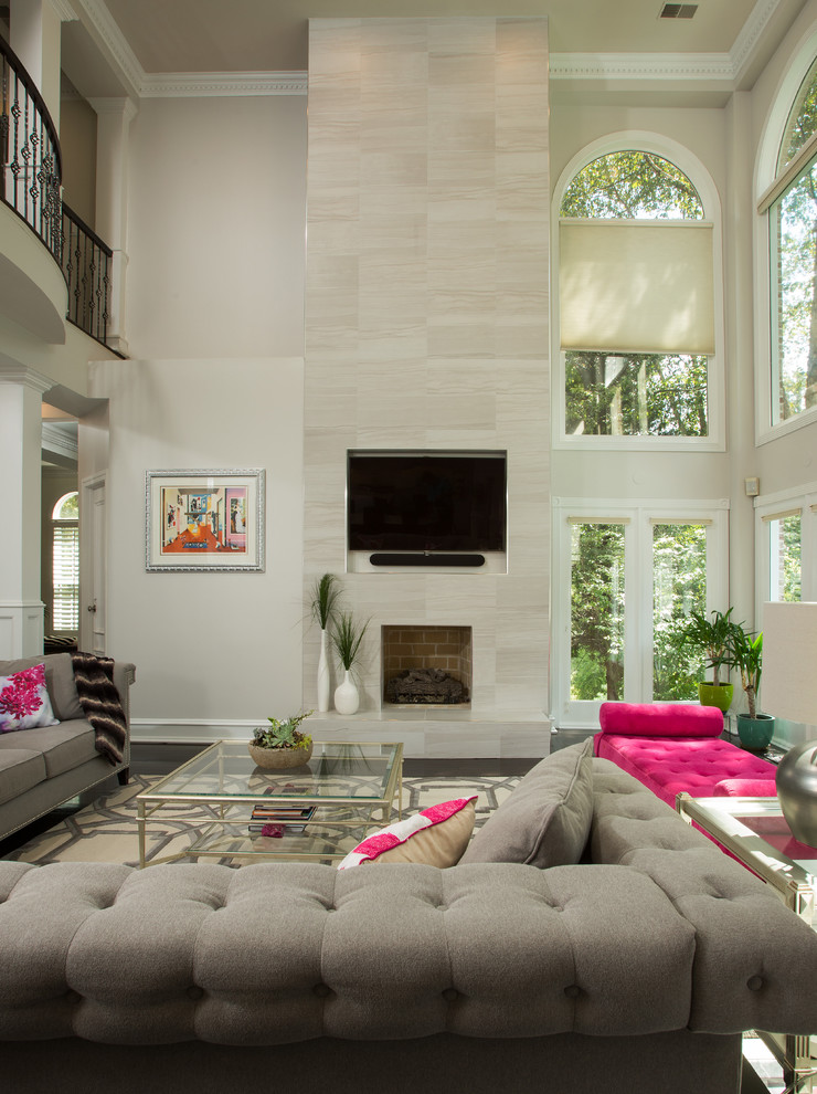 Trendy formal and open concept living room photo in DC Metro with beige walls, a standard fireplace, a brick fireplace and a media wall