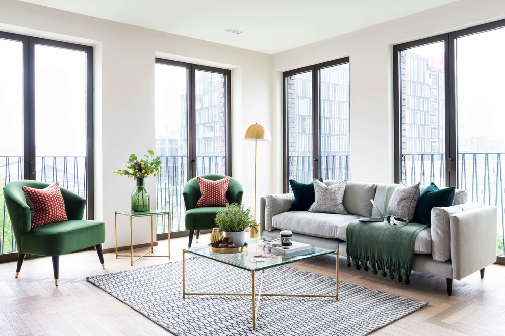 Example of a trendy beige floor living room design in London with white walls