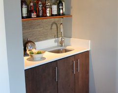 Modern Built-in Wet Bar with Walnut Cabinet and Quartz Counter Top midcentury living room