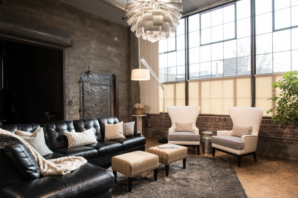 Example of an urban formal and open concept plywood floor living room design in St Louis with gray walls and a wall-mounted tv