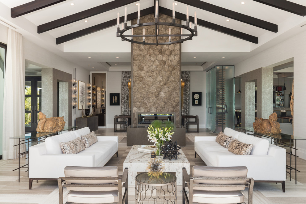 Living room - coastal formal beige floor living room idea in Tampa with gray walls and a two-sided fireplace