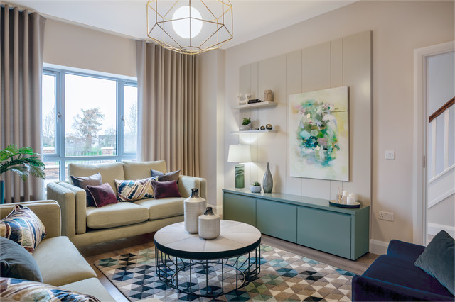 Inspiration for a mid-sized contemporary light wood floor living room remodel in Dublin with beige walls and a media wall