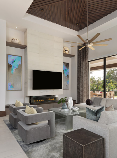 Example of a large minimalist open concept porcelain floor and beige floor living room design in Miami with white walls, a ribbon fireplace, a wall-mounted tv and a tile fireplace