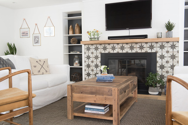 Inspiration for a large country open concept light wood floor and brown floor living room remodel in Boston with white walls, a standard fireplace, a concrete fireplace and a wall-mounted tv