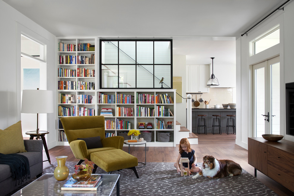 Mid-sized cottage living room library photo in Austin