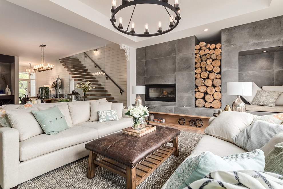 Inspiration for a large farmhouse open concept light wood floor and beige floor living room remodel in Calgary with white walls, a tile fireplace and a standard fireplace
