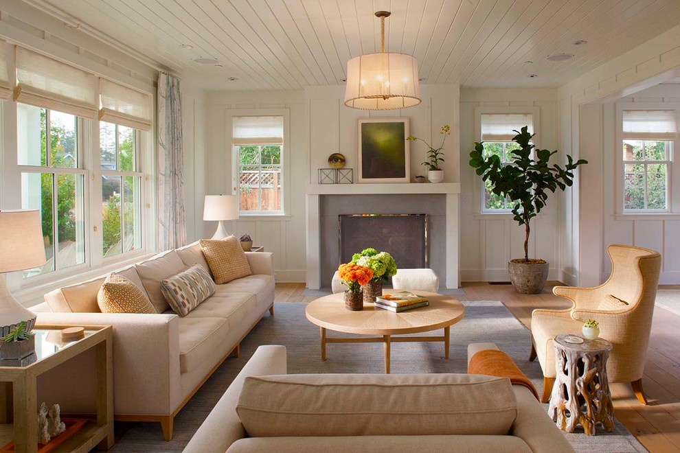 Living room - country formal light wood floor living room idea in San Francisco with white walls, a standard fireplace and no tv
