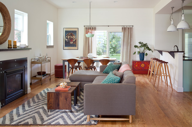 Example of a mid-sized country open concept medium tone wood floor living room design in Denver with white walls, a standard fireplace and a metal fireplace