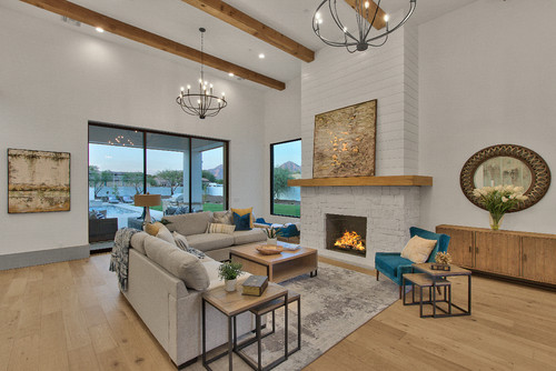 open fire with exposed beams and vaulted ceiling