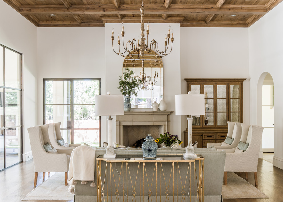 Example of a french country living room design in Dallas