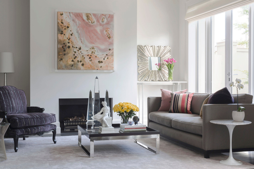 Example of a huge trendy open concept carpeted and pink floor living room design in Melbourne with white walls, a standard fireplace, a plaster fireplace and a concealed tv