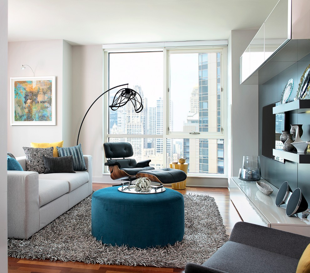 Inspiration for a modern living room remodel in Chicago with white walls and a wall-mounted tv