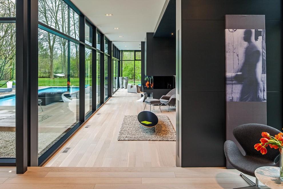 Inspiration for a scandinavian beige floor living room remodel in Toronto with black walls